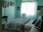 Calm powder blue room has smart tv and cable. All rooms have AC!
