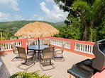 Large patio facing El Yunque Rainforest mountains, valley, and ocean!