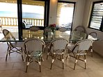 The indoor dining table seats 10, with 4 bar stools at the nearby island.