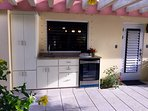 The pool kitchen has a pro gas grill and beverage and wine refrigerator. Grill under the stars!