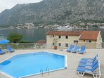 The pool and sun loungers with views across the Bay to Kotor.