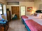 Each bedroom suite has attractive, individually chosen artwork.