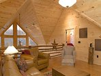 Loft Area features Complete Living Area Setup—Leather Seating, Coffee Tables...