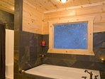 Master Suite Private Bath features Jetted Tub, Separate Shower & Walk-In Closet