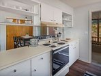 Kitchen has views to all living areas as well as newly planted vineyard just beyond the deck