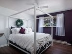 Frame canopy queen bed in spacious bedroom
