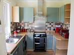 Bright kitchen with microwave, dishwasher, washer/dryer and views over the large back garden