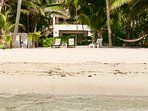 Water's edge is a few steps away on a sandy beach