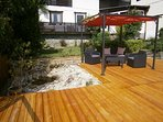 New wooden Terrace with pond.