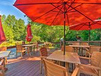Dine al fresco on this spacious deck with a view of the pond.