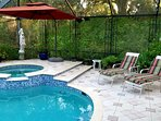 Huge screened-in pool area with lots of toys for the kids and a heated spa for the adults