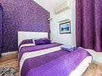 1st floor, purple apartment