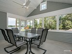 Screen porch with dining set