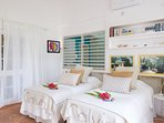 2 twin beds can convert to king size. Listen to the ocean as you fall asleep