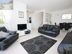 Large and comfortably furnished lounge with light, bright and spacious interior. Views from sofas.