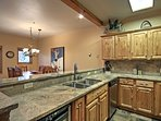 The kitchen offers ample granite counter space and stainless steel appliances.