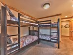 Level 1 Bedroom 3 with Two Twin over Twin Bunk Beds with a Private Bath and Patio Access with Hot Tub
