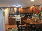 Fully applianced kitchen complete with dishware, glassware, utensils and  cookware