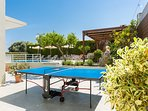 Ping pong table can also be found for unlimited hours of fun!
