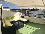 West facing roof terrace with awning