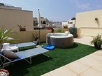 Sunbathing or simply relax in your own sunbeds and decking area