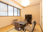 Tatami mat living area with large screen TV