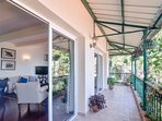 The veranda overlooks the valley down below and adjoins the living and the dining area