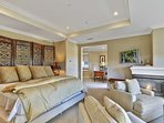 Master bedroom with king size bed, fireplace, view of golf course and private bath