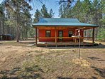 Escape to this serene 2-bedroom, 1-bath South Boardman vacation rental cabin.