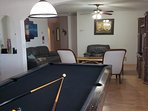 Pool table and living room