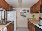 Full kitchen with refrigerator, dishwasher, stove and microwave.