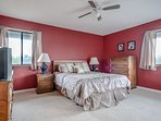 Spacious master bedroom with queen size bed, TV and private bath.