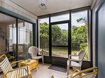 Enjoy the outdoors from your screened in porch.
