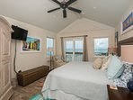 Oceanfront master bedroom, located on the 3rd level, with king, flat screen TV, DVD, and private oceanfront balcony.