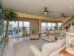 Open floor plan with spacious living room feature a flat screen HDTV.