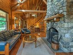 The stone wood-burning fireplace highlights the inviting living room.