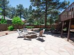 The large fenced backyard with Flagstone patio & fire pit. Corn hole, anybody?