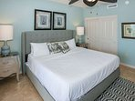 Guest room with queen bed and ceiling fan