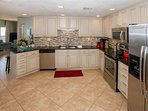 Large fully equipped kitchen with stainless steel appliances