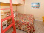 Guest room with double bed on bottom and twin bed on top