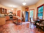 Fully stocked kitchen with access to upper deck!