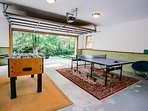 Garage game room with ping pong and foosball