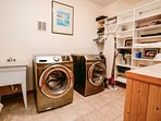 Large laundry room with lots of shelf space