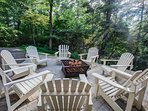 Relax around the fire pit on an adirondack chair!