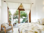 Second bedroom overlooking the upstairs veranda, garden and ocean.