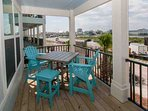 Private deck with bistro table and chairs