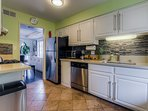 The freshly remodeled kitchen has stainless steel appliances & stone work tops