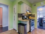 The kitchen includes a coffee maker, kettle and toaster