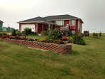 Front of property, beautiful landscaping on a half acre lot.