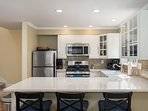 The kitchen is modern and well equipped, with plenty of room to work and entertain